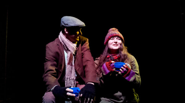 Simeon (John Holden-White) and Rina (Katie Brier) sharing a cup of cocoa out in the fields